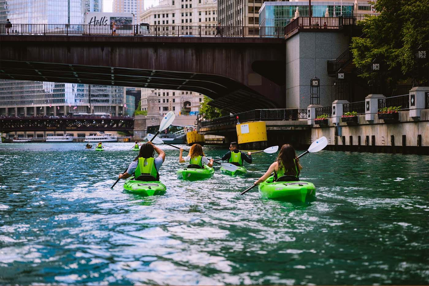 A group of people Kayaking down the river in Chicago